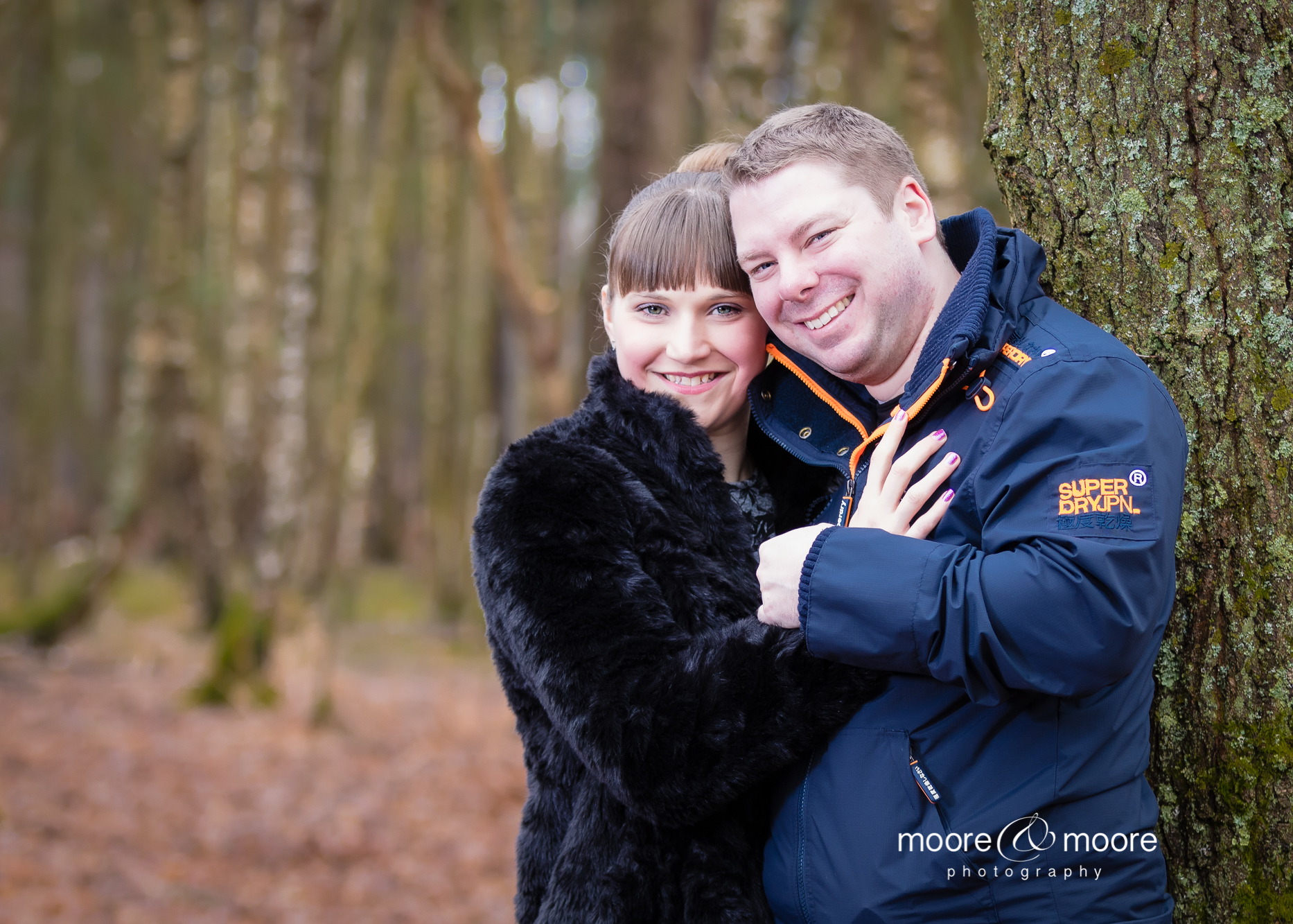 we love this portrait of the engaged couple - engagement photography down in the woods. photo by Helen Moore at moore&moore photography, Hampshire